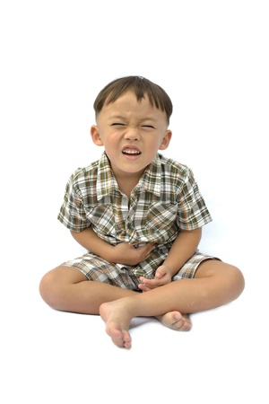 upset stomach: One boy with facial expression on white background. Stock Photo