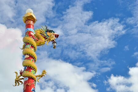 Dragon pilr in chinese temple against blue sky. photo