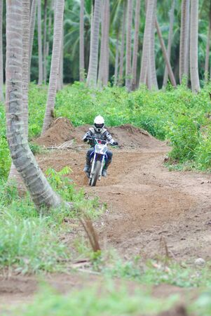 KO SAMUI, THAILAND - DECEMBER 4: Panning view of unidentified rider during the