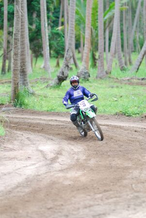 KO SAMUI, THAILAND - DECEMBER 4: Panning view of unidentified rider during the