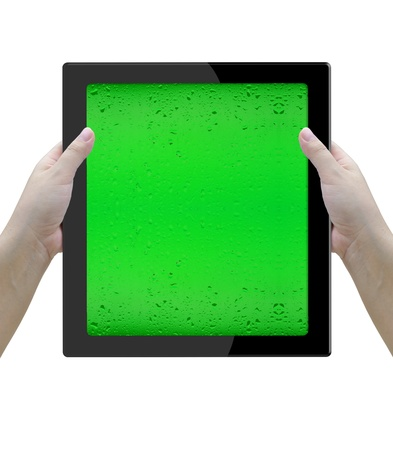Holding tablet computer with two woman hands over white background. photo
