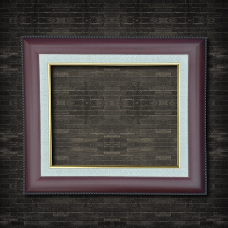 Photo frame on old brick wall. photo