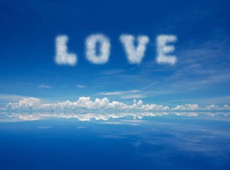 Word love of cloud over blue sky. photo