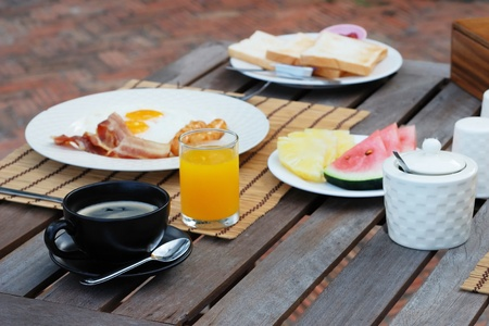 set of american breakfast on wood table. photo