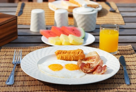 set of american breakfast on wood table. photo