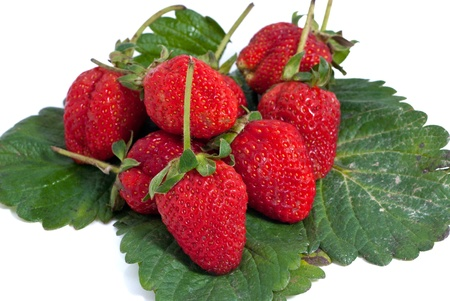 Fresh strawberry stack on leave over white background. photo