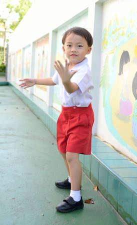 Cute asian young school boy in the school. photo