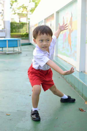 Cute asian young school boy in the school. Stock Photo - 13197386