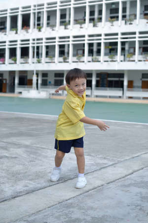 Cute asian young boy in the school. photo