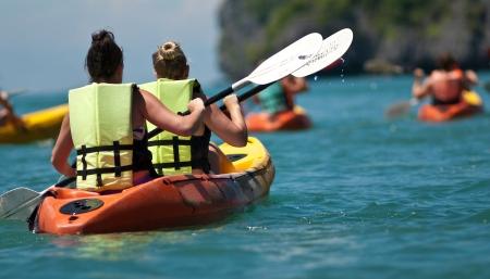 kayak: traveler kayaking in the thai ocean from backward view