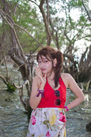 Cute young asian woman portrait on the beach. photo