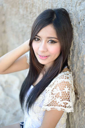 Cute young asian woman portrait outdoor scene. photo