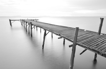 balck and white picture of old bridge to the sea. Reklamní fotografie