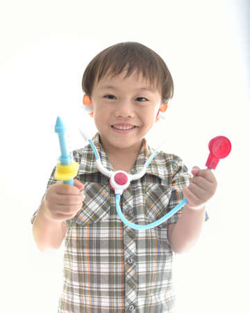 Cute asian boy with medical toy  on white background. photo