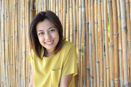 Cute young asian woman portrait outdoor scene. photo