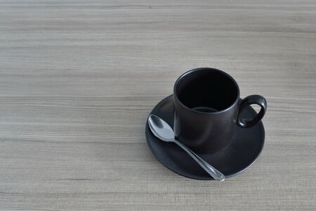 Empty Black coffee cup on wood background. photo