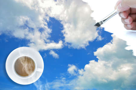 drawing sky with paintbrush and top view coffee cup. Stock Photo - 12838784