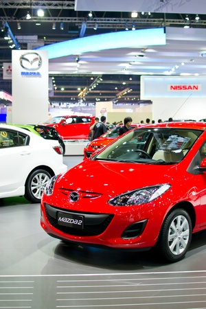NONTHABURI, THAILAND - MARCH 28: The Mazda 2 red model  in the 33rd Bangkok International Motor Show on March 28, 2012 in Nonthaburi, Thailand. Stock Photo - 13022387
