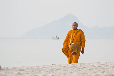 HUAHIN - MARCH 26: Early morning activity of monk on the beach at Huahin Thailand. on March 26, 2012 in Huahin, Thailand.