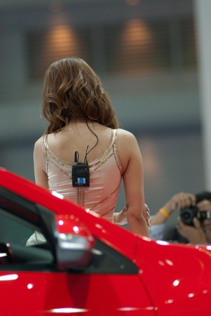 BANGKOK - MARCH 28: Female presenter model with car at the 33th Bangkok Motor show exhibition on March 28, 2012 in Bangkok, Thailand.