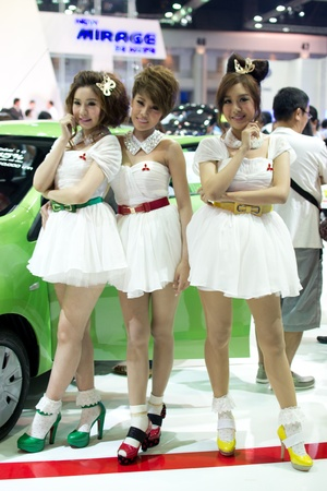 nontaburi: BANGKOK - MARCH 28: Female presenter model with car at the 33th Bangkok Motor show exhibition on March 28, 2012 in Bangkok, Thailand.