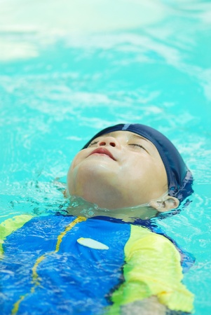 kiddie: Cute young boy in swimming suit in the pool. Stock Photo
