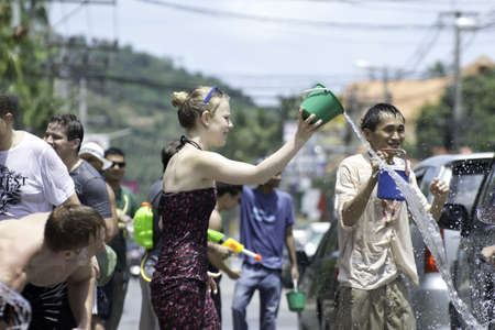 KO SAMUI, THAILAND - APRIL 13: Traveler and local Thai people enjoy throwing water at each other in Thailand new year festival called songkran festival on April 13, 2012 in Ko Samui island, Thailand.