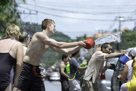 KO SAMUI, THAILAND - APRIL 13: Traveler and local Thai people enjoy throwing water at each other in Thailand new year festival called songkran festival on April 13, 2012 in Ko Samui island, Thailand. Stock Photo - 13204374