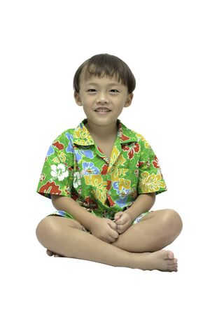 thai boy: Small Thai boy in traditional form on white background. Stock Photo