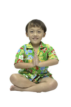 Small Thai boy in traditional form on white background. photo