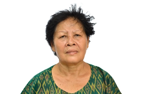 Portrait of and old asian woman on white background. photo