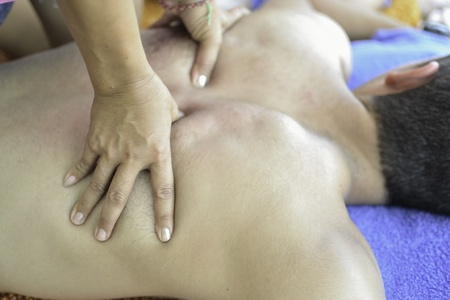 Famous Thai massage  ,therapist action on customer. photo