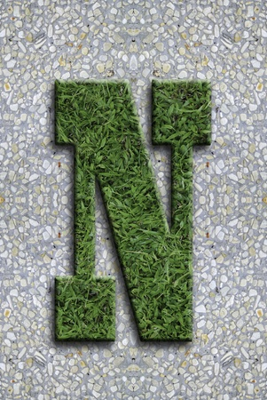 Illustrated grass background font on seamless concrete wall background. Stock Photo - 13254618