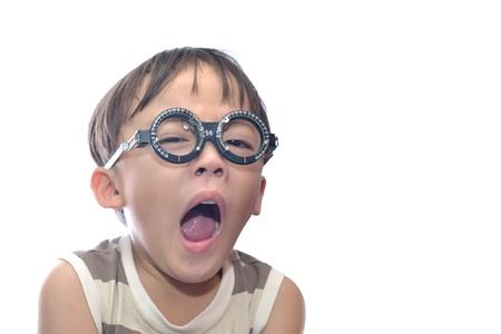 Small boy with eye examination. photo