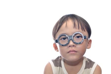Small boy with eye examination. Standard-Bild