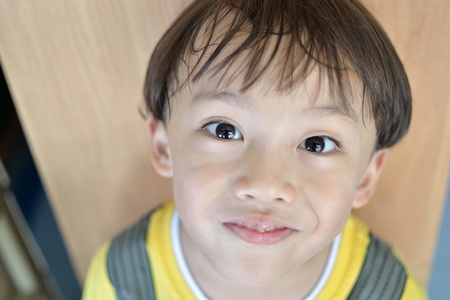 Asian boy portrait with yellow t shirt. Stock Photo - 13259339