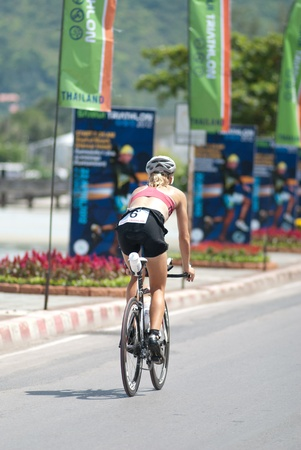 SAMUI, THAILAND - APRIL 22 2012: Samui triathlon 2012 event. Competitors in action during the triathlon on Sunday 22 April 2012 in Ko Samui island, Suratthani, Thailand.