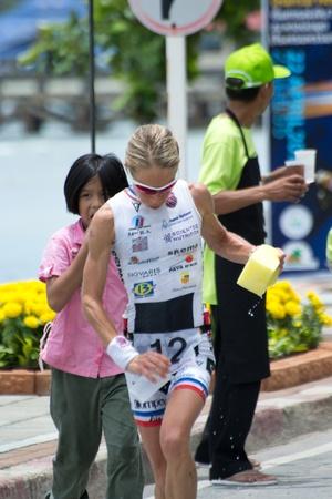 SAMUI, THAILAND - APRIL 22 2012: Samui triathlon 2012 event. Competitors in action during the triathlon on Sunday 22 April 2012 in Ko Samui island, Suratthani, Thailand. Stock Photo - 13337056