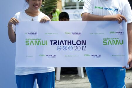 SAMUI, THAILAND - APRIL 22 2012: Samui triathlon 2012 event. At the finish point of  the triathlon on Sunday 22 April 2012 in Ko Samui island, Suratthani, Thailand.