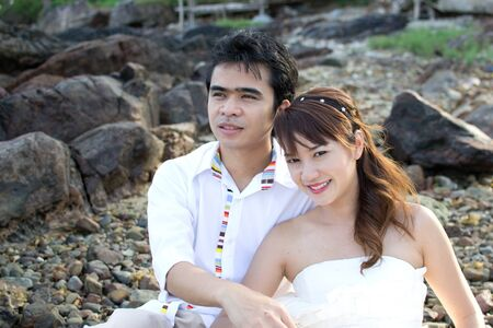 Asian couple with pre wedding sceen out door bckground. Stock Photo - 13371401
