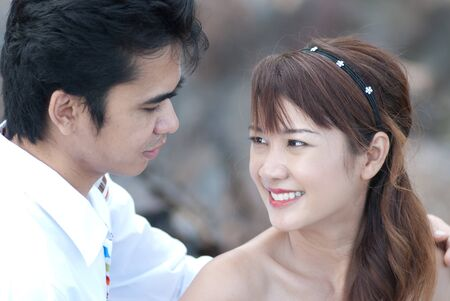 Asian couple with pre wedding sceen out door bckground. Stock Photo - 13371206
