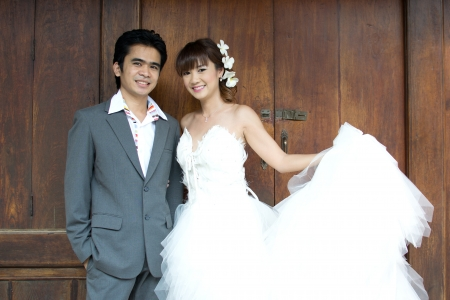 Asian couple with pre wedding scene out door background. photo