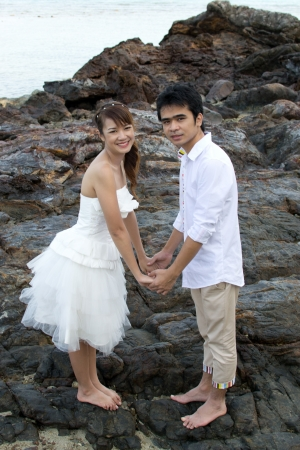 Asian couple with pre wedding sceen out door bckground. photo