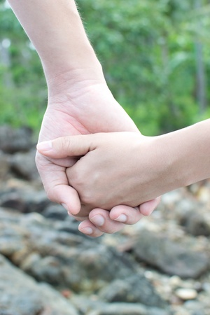 hands with love sign pre wedding sceen out door bckground. Stock Photo - 13371690