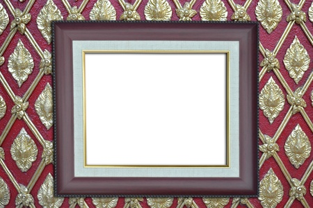 Wood frame over asian religious golden pattern on red wall, Thailand photo