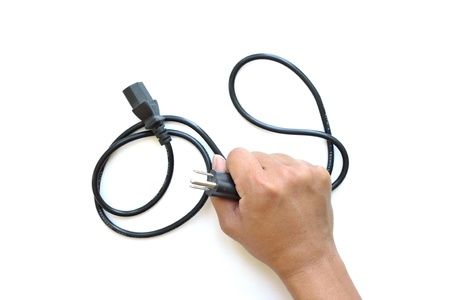 Classic AC cable on white background, Cable in hand. photo