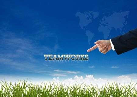 Attractive artwork of business wording on clear sky background with businessman's hand. photo