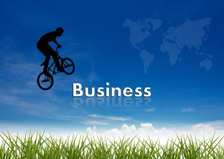 bmx rider jumping over business wording on nature background.