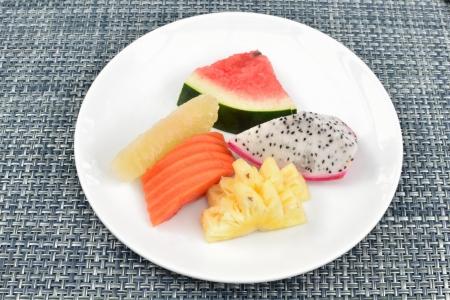 Breakfast mixed fruit dish on table. photo