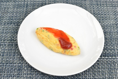 Breakfast scramble egg dish on table. photo